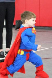 Young boy dressed as superman