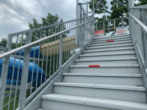 Red tape on water slide stairs