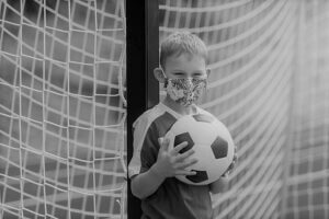youth soccer player with mask