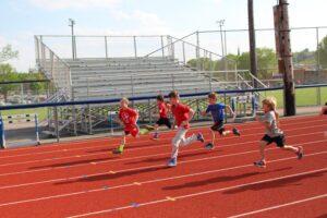 Kids racing on track